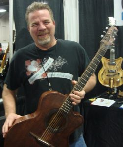 Randy with the custom cowboy guitar