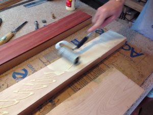 Rolling the titebond glue onto one of the maple stripes.