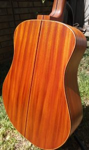 Back of mahogany dreadnought acoustic guitar.
