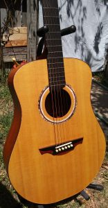 Mahogany dreadnought acoustic guitar.